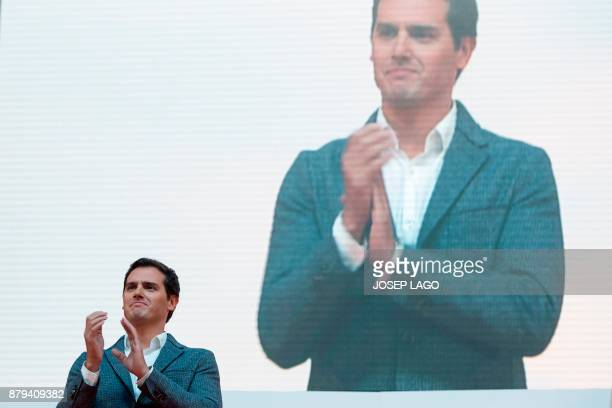 Leader of the centerright party Ciudadanos Albert Rivera applauds during a meeting to present the party´s political campaign for the upcoming...