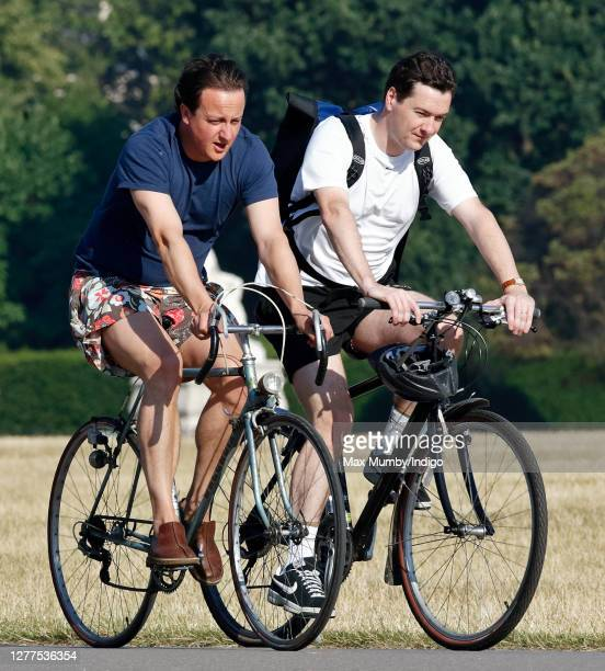 Leader of the Conservative Party David Cameron and Shadow Chancellor of the Exchequer George Osborne seen cycling through Hyde Park on July 19, 2006...