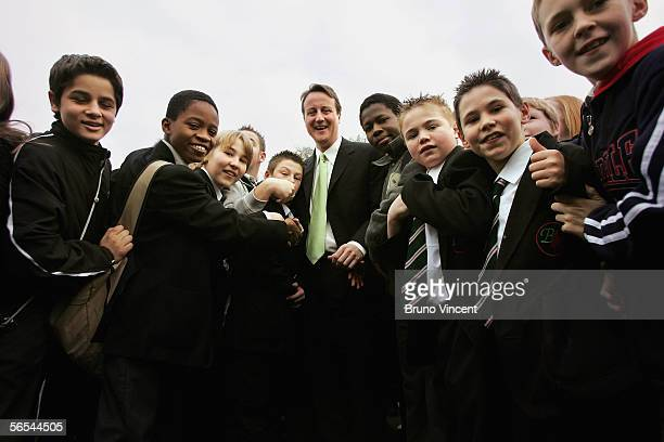 Leader of the Conservative party David Cameron poses for a photograph with pupils from Barstable School on January 9 2006 in Basildon England The...