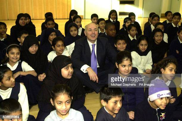 Leader of the Conservative Party Iain Duncan Smith joins school children at assemble during a visit to Kobi Nazrul Primary School in Stepney east...