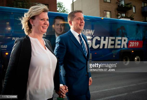 Leader of the Conservative Party of Canada Andrew Scheer arrives with wife Jill Scheer for the French debate for the 2019 federal election the...
