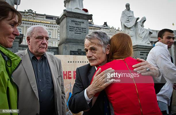 Leader of the Crimean Tatars Mustafa Dzhemilev greats people during a requiem quotLight a flame in your heartquot in Kiev to honor the victims of the...