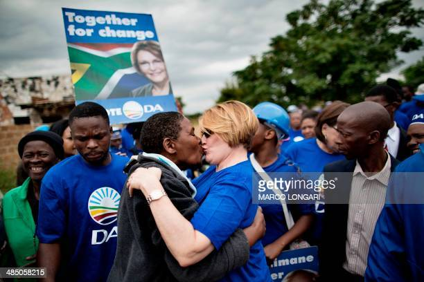 Leader of the Democratic Alliance Helen Zille kisses a resident of the Chris Hani informal settlement in Hammanskraal during a doortodoor campaign...
