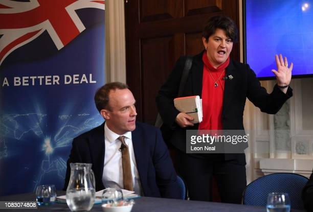 Leader of the Democratic Unionist Party Arlene Foster passes Former Secretary of State for Exiting the European Union Dominic Raab during a press...
