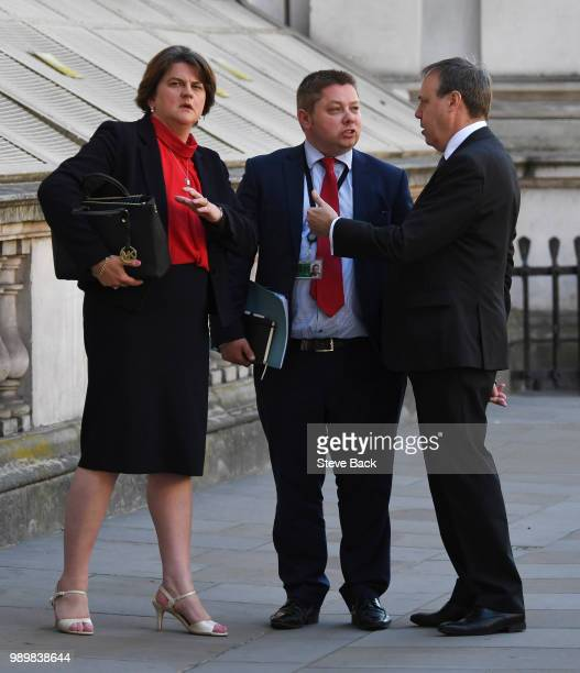 Leader of the Democratic Unionist Party Nigel Dodds and First Minister of Northern Ireland Arlene Foster with DUP Timothy Johnson after speaking to...