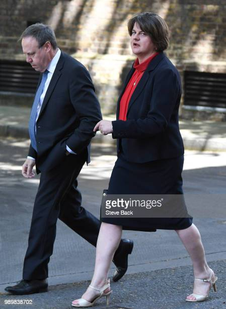 Leader of the Democratic Unionist Party Nigel Dodds and First Minister of Northern Ireland Arlene Foster before speaking to the media outside 10...