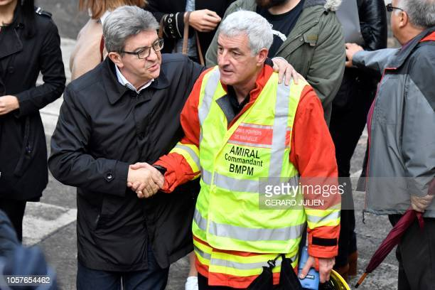 Leader of the far-left party France Insoumise , Marseille deputy, Jean-Luc Melenchon talks with vice-amiral Charles-Henri Garie, director of the fire...
