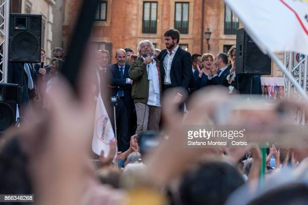 Leader of the Five Star Movement Beppe Grillo speaks flanked by Five Star Movement MP Alessandro Di Battista during the demonstration by the 5 Star...