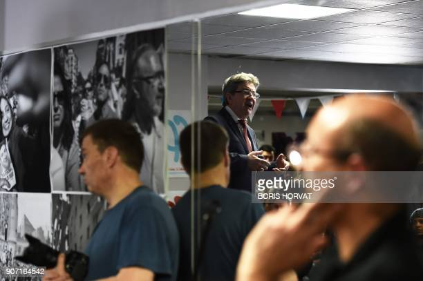 Leader of the French leftist party La France Insoumise and member of parliament JeanLuc Melenchon is reflected in a mirror as he delivers his New...