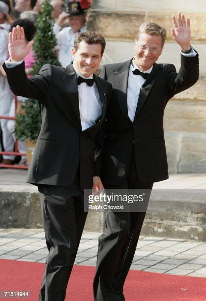 Leader of the German Liberal party Guido Westerwelle and his partner Michael Mronz arrive for the opening performance of Richard Wagner's Der...