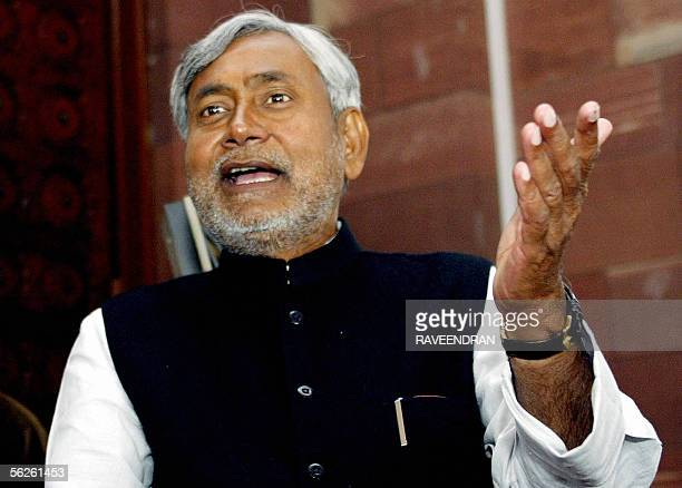 Leader of the Indian political party Janata DalUnited Nitish Kumar chats to the media on his arrival at Parliament House in New Delhi 23 November...