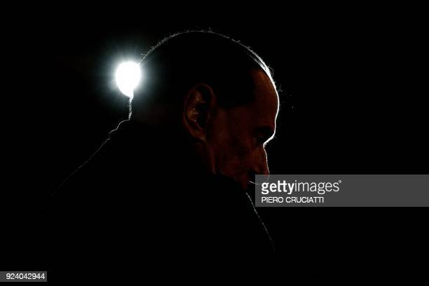 TOPSHOT Leader of the Italian rightwing party Forza Italia Silvio Berlusconi looks on during a campaign rally in Milan on February 25 ahead of the...