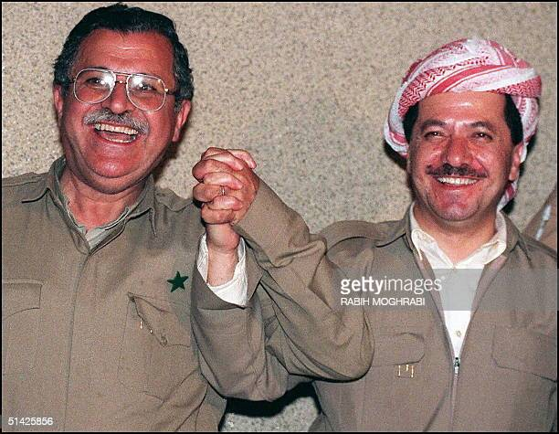 Leader of the Kurdistan Democratic Party Massoud Barzani and leader of the Patriotic Union of Kurdistan Jalal Talabani hold hands after announcing...