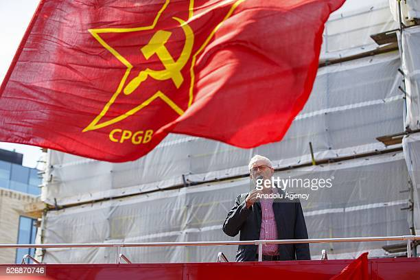 Leader of the Labour Party and Leader of the Opposition Jeremy Corbyn speaks at a May Day march in London England to celebrate International Workers'...