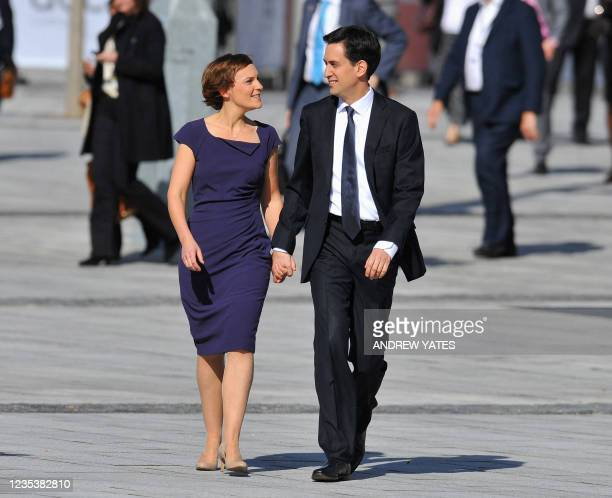 Leader of the labour party Ed Miliband arrives with wife Justine for his speech during the third day of the annual Labour pary conference in...