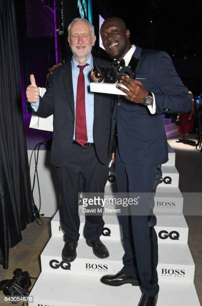 Leader of the Labour Party Jeremy Corbyn and Stormzy winner of the Solo Artist of the Year award attend the GQ Men Of The Year Awards at the Tate...