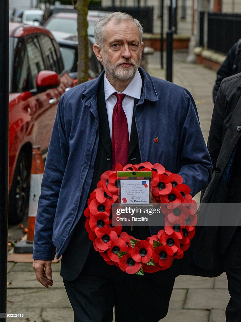 Leader of the Labour Party Jeremy Corbyn carries a wreath at Royal Northern Gardens in Islington on November 8, 2015 in London, England. The Labour Party leader observes Remembrance Sunday at the North Islington war memorial in Manor Gardens, where he read poem 'Futility' by Wilfred Owen. This was after attending the national service of remembrance at the Cenotaph in Whitehall with the Queen this morning.