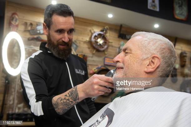 Leader of the Labour Party Jeremy Corbyn gets his beard cut at Big Mel's barber shop on December 7, 2019 in Carmarthen, Wales. The UK will go to the...