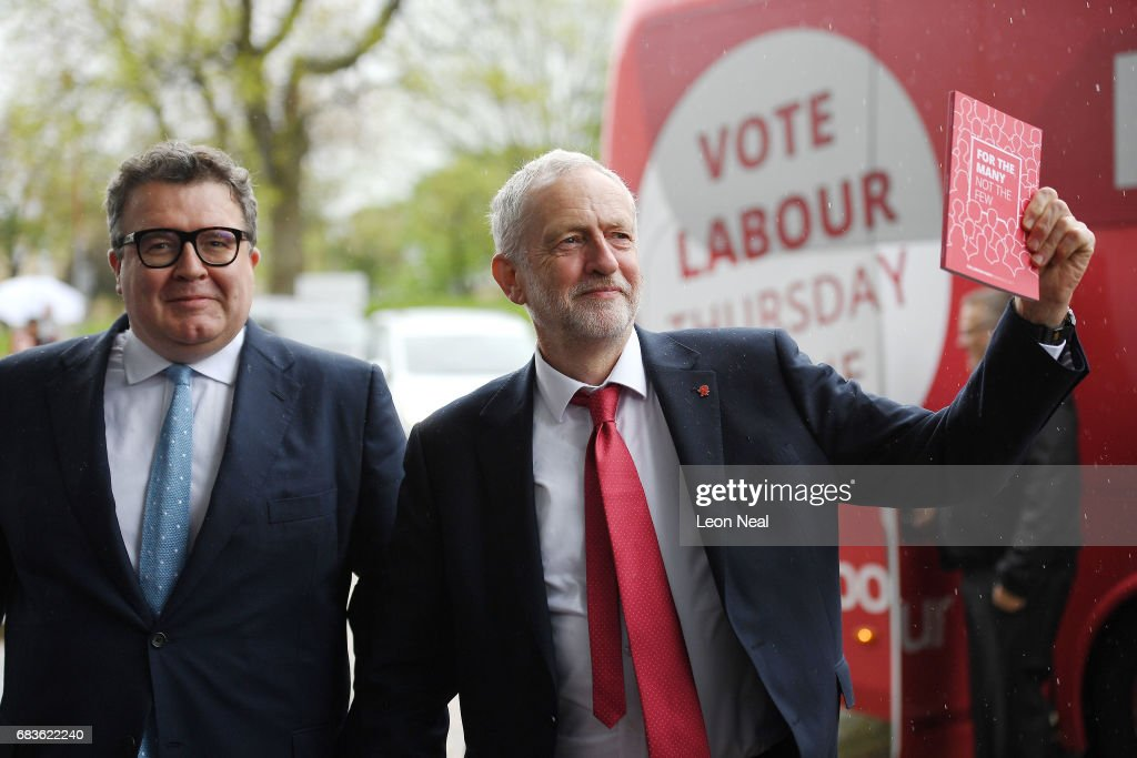 Leader of the Labour Party Jeremy Corbyn holds a copy of the manifesto as he arrives with Deputy Leader Tom Watson prior to the launch of the Labour Party Election Manifesto, at Bradford University on May 16, 2017 in Bradford, England. Britain will vote in a general election on June 8.