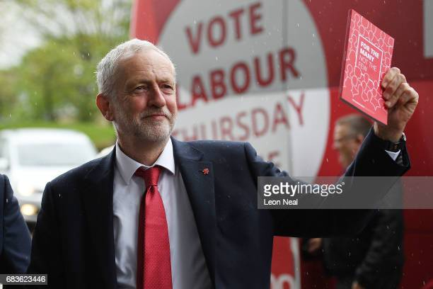 Leader of the Labour Party Jeremy Corbyn holds a copy of the manifesto as he arrives prior to the launch of the Labour Party Election Manifesto at...