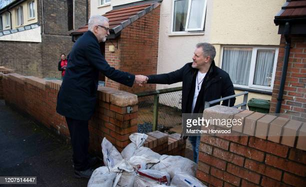 Leader of the Labour Party Jeremy Corbyn meets flood victim Richard Oliver at Wordsworth Gardens on February 20 2020 in Rhydyfelin Wales Residents...