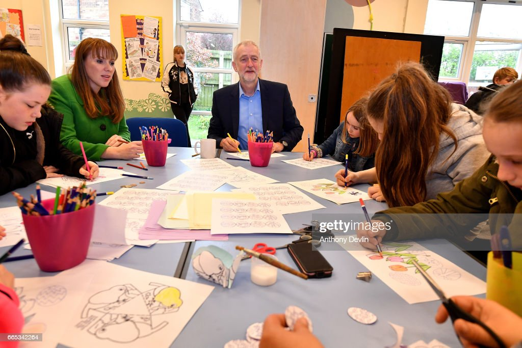 Leader of the Labour Party Jeremy Corbyn MP (C) and Shadow Secretary for Education Angela Rayner (2nd R) join a craft workshop during a visit to a children's holiday club in Leyand where he made an education policy announcement on April 6, 2017 in Leyland, England. The Leyland Project provides services to the community, including after School provisions, lunch clubs and youth clubs. The project uses cookery as an activity for families who rely on free school meals in term times as it becomes a struggle to cover the extra cost in the holidays.