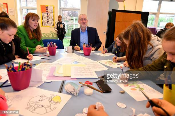 Leader of the Labour Party Jeremy Corbyn MP and Shadow Secretary for Education Angela Rayner join a craft workshop during a visit to a children's...