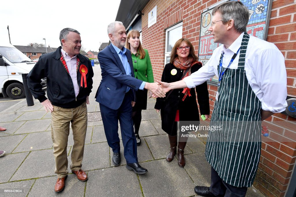 Leader of the Labour Party Jeremy Corbyn MP (C) and Shadow Secretary for Education Angela Rayner (3rd L) are greeted by Tony Crawford, Chair of Trustees and local candidate Gail Hodson (2nd R) as they arrive to visit a children's holiday club in Leyand to make an education policy announcement on April 6, 2017 in Leyland, England. The Leyland Project provides services to the community, including after School provisions, lunch clubs and youth clubs. The project uses cookery as an activity for families who rely on free school meals in term times as it becomes a struggle to cover the extra cost in the holidays.