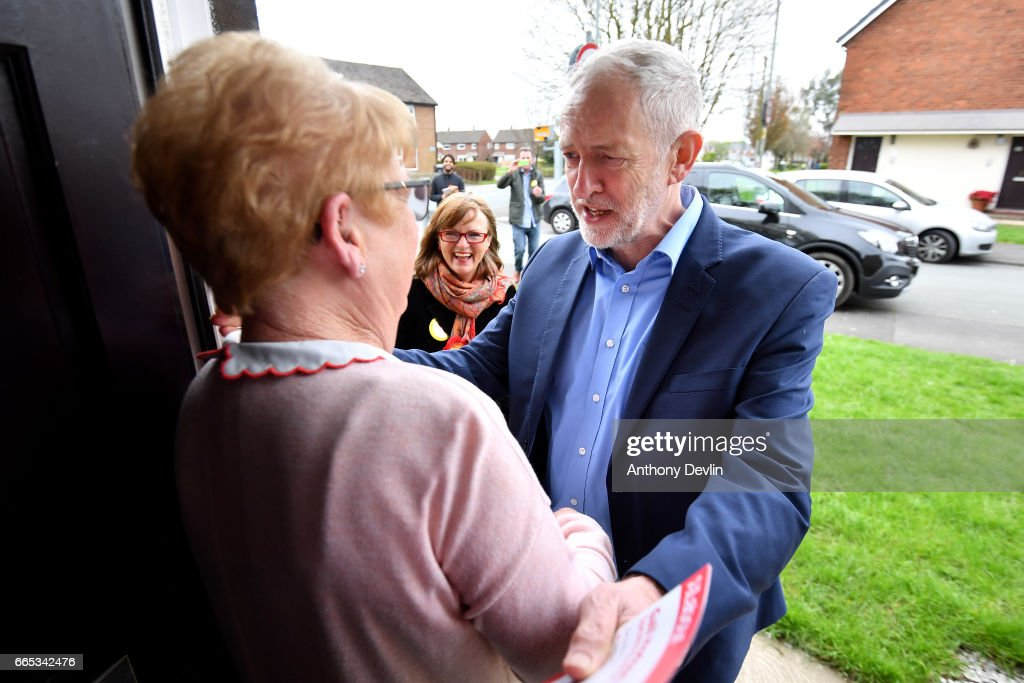 Leader of the Labour Party Jeremy Corbyn MP (R) greets local resident Catherine Finney as he canvasses with local Labour candidate Gail Hodson (C) for the upcoming local elections in Leyland where he earlier visited a children's holiday club and made an education policy announcement on April 6, 2017 in Leyland, England. The Leyland Project provides services to the community, including after School provisions, lunch clubs and youth clubs. The project uses cookery as an activity for families who rely on free school meals in term times as it becomes a struggle to cover the extra cost in the holidays.