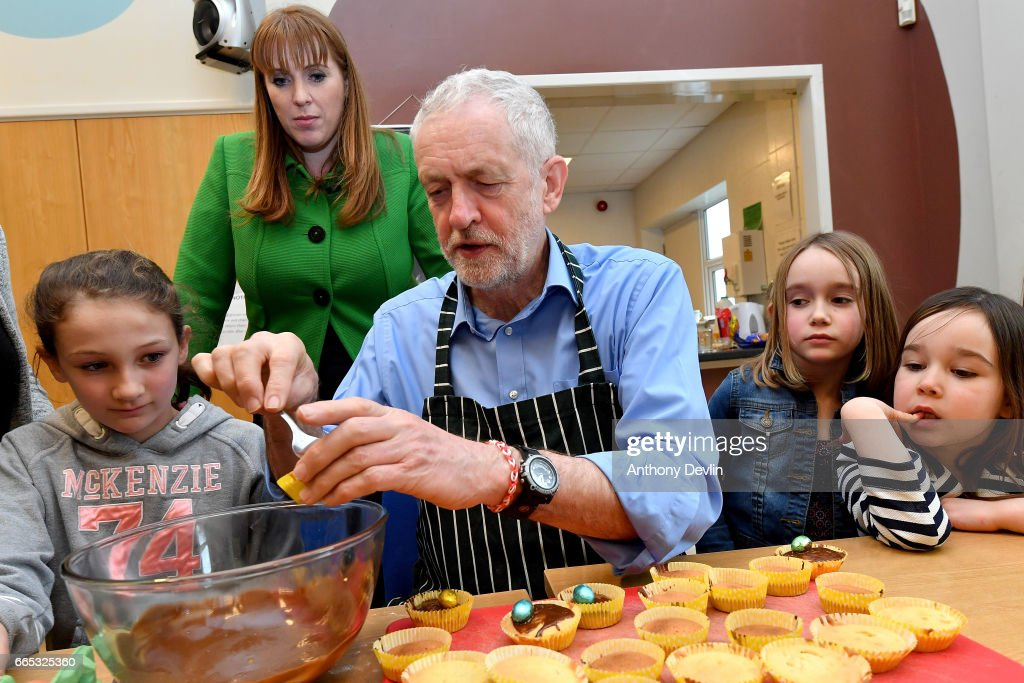 Leader of the Labour Party Jeremy Corbyn MP makes fairy cakes with McKenzie Fitzgerald (L) Shadow Secretary for Education Angela Rayner (2nd L) Zofia Bylinski-Gelded (2nd R) and Lyra Bylinski (R) during a visit to a children's holiday club in Leyand where he made an education policy announcement on April 6, 2017 in Leyland, England. The Leyland Project provides services to the community, including after School provisions, lunch clubs and youth clubs. The project uses cookery as an activity for families who rely on free school meals in term times as it becomes a struggle to cover the extra cost in the holidays.