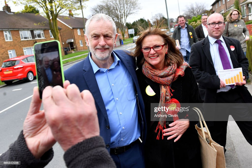 Leader of the Labour Party Jeremy Corbyn MP (L) poses for a photograph with local labour candidate Gail Hodson as they canvas for the upcoming local elections in Leyland where he earlier visited a children's holiday club and made an education policy announcement on April 6, 2017 in Leyland, England. The Leyland Project provides services to the community, including after School provisions, lunch clubs and youth clubs. The project uses cookery as an activity for families who rely on free school meals in term times as it becomes a struggle to cover the extra cost in the holidays.