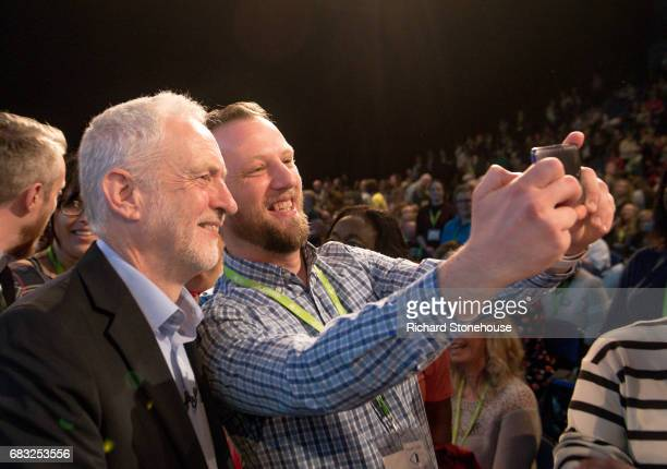 Leader of the Labour Party Jeremy Corbyn poses for a selfie with a nurse after he spoke at the Royal College of Nursing Congress on May 15 2017 in...