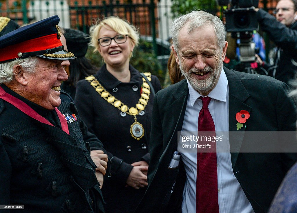 Leader of the Labour Party Jeremy Corbyn shares a joke with veterans after laying a wreath and speaking at a war memorial at Royal Northern Gardens in Islington on November 8, 2015 in London, England. The Labour Party leader observes Remembrance Sunday at the North Islington war memorial in Manor Gardens, where he read poem 'Futility' by Wilfred Owen. This was after attending the national service of remembrance at the Cenotaph in Whitehall with the Queen this morning.