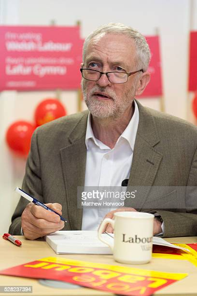 Leader of the Labour Party Jeremy Corbyn signs a book for a supporter during a visit to Maesteg on May 4 2016 in Bridgend Wales Tomorrow the UK will...