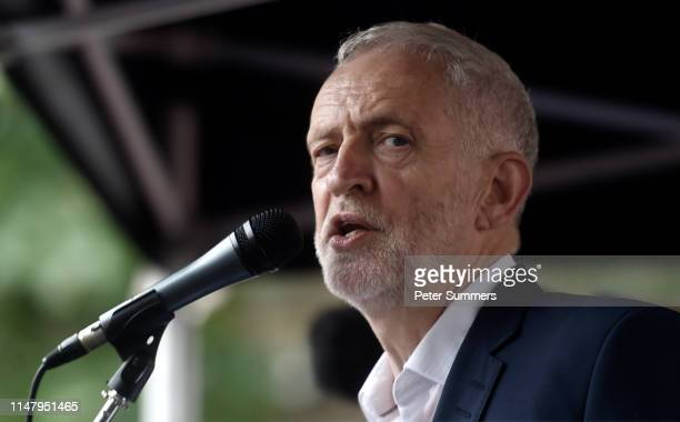 Leader of the Labour Party Jeremy Corbyn speaks to protesters during a demonstration outside the Houses of Parliament on the second day of U.S....