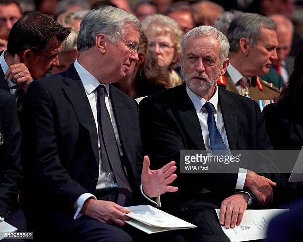 Leader of the Labour Party Jeremy Corbyn speaks with British Defence Secretary Michael Fallon before a Service on the Eve of the Centenary of the...