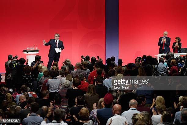Leader of the Labour Party Jeremy Corbyn stands up and applauds Deputy leader of the Labour party Tom Watson following his keynote speech to...