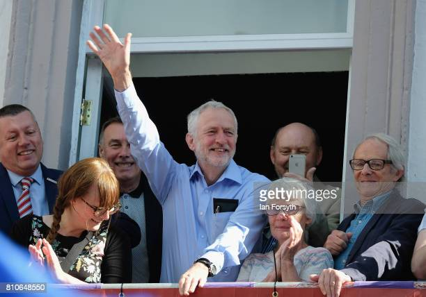 Leader of the Labour Party Jeremy Corbyn waves to crowds as he stands with film director Ken Loach as they watch colliery bands pass below the County...