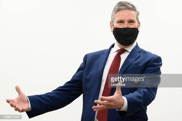 Leader of the Labour Party Keir Starmer speaks with members of the NHS team at the NHS vaccination centre in Robertson House on January 14, 2021 in...