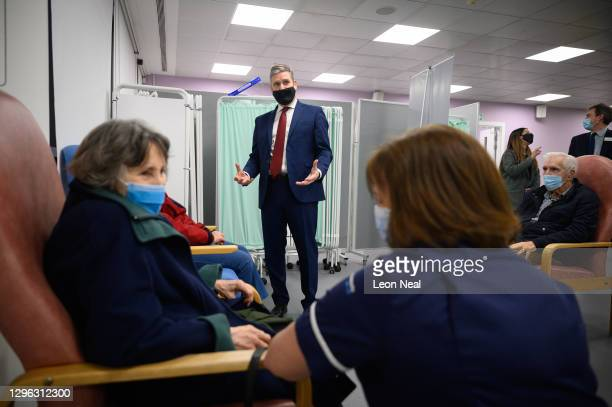 Leader of the Labour Party Keir Starmer speaks with people after they received the first of two vaccination shots at the NHS vaccination centre in...