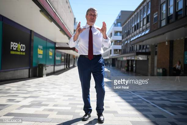 Leader of the Labour Party Sir Keir Starmer walks through a pedestrianised area as he makes a visit to small businesses on June 25 2020 in Stevenage...