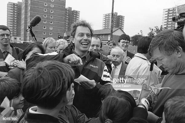 Leader of the Labour Party Tony Blair MP visits Devonshire Primary School in Blackpool with Alex Ferguson, manager of Manchester United Football...