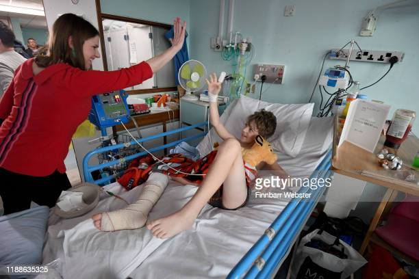 Leader of the Liberal Democrats Jo Swinson chats to William Vernon aged 9 during her visit to the children's emergency department and wards at...