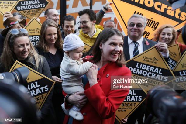 Leader of the Liberal Democrats Jo Swinson holds three month old San Skinner as she attends an election campaign event in Golders Green on November 6...