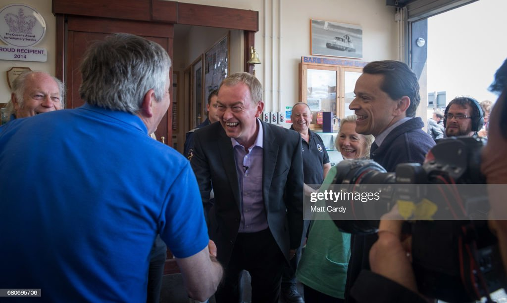 Leader of the Liberal Democrats Tim Farron (C) campaigns at a volunteer-run Rescue Boat Service on May 9, 2017 at Burnham-on-Sea, England. Campaigning is underway ahead of the June 8th general election.