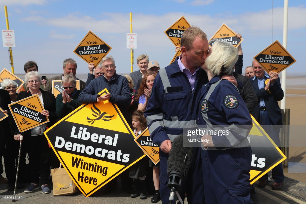 Leader of the Liberal Democrats Tim Farron greets a volunteer as he campaigns at a volunteer-run Rescue Boat Service on May 9, 2017 at Burnham-on-Sea, England. Campaigning is underway ahead of the June 8th general election.