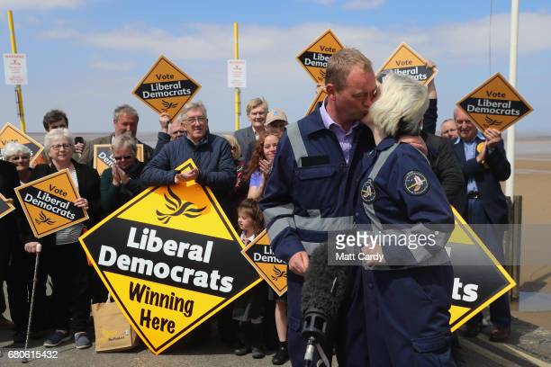 Leader of the Liberal Democrats Tim Farron greets a volunteer as he campaigns at a volunteer-run Rescue Boat Service on May 9, 2017 at...
