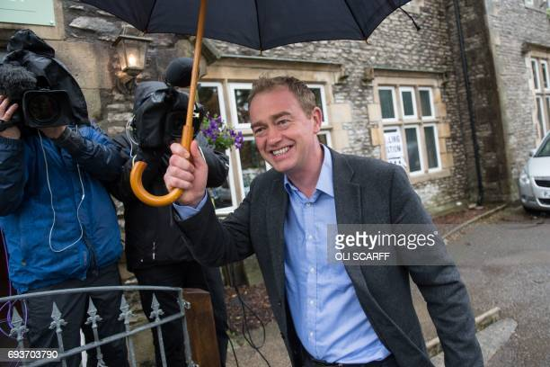 Leader of the Liberal Democrats Tim Farron leaves a polling station after voting in Kendal northwest England on June 8 as Britain holds a general...