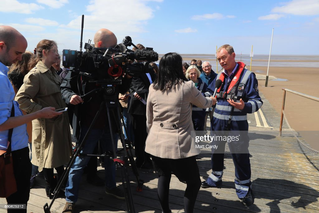 Leader of the Liberal Democrats Tim Farron speaks to the media as he campaigns at a volunteer-run Rescue Boat Service on May 9, 2017 at Burnham-on-Sea, England. Campaigning is underway ahead of the June 8th general election.