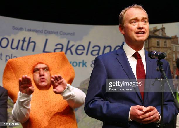 Leader of the Liberal democrats Tim Farron stands in front of Independent candidate Mr Fishfinger following the announcement of the results and that...